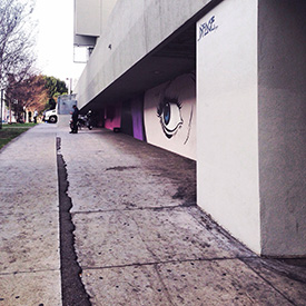 Mural by street artist D*Face on the side of The Line Hotel
