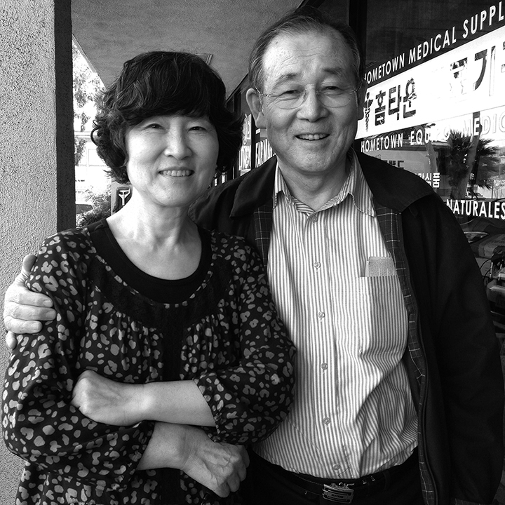 My parents outside the medical supply store back in March
